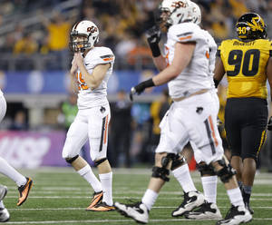 Photo - Oklahoma State's Ben Grogan (19) reacts after missing a field goal during the AT&T Cotton Bowl Classic college football game between the Oklahoma State University Cowboys (OSU) and the University of Missouri Tigers at AT&T Stadium in Arlington, Texas, Friday, Jan. 3, 2014. Photo by Bryan Terry, The Oklahoman
