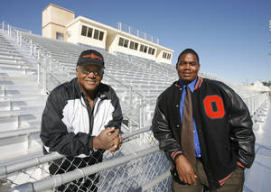 Photo - Former Douglass High School Head Football Coach Stanford White (left) and current Coach Willis Alexander stand in the bleachers of the new Douglass High School Stadium in Oklahoma City, Okla., Tuesday, October 23, 2007. Photo by Paul Hellstern / The Oklahoman