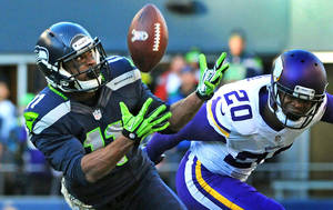 Photo - In this Nov. 17, 2013, photo, Seattle Seahawks wide receiver Percy Harvin catches a 17-yard pass from quarterback Russell Wilson as Minnesota Vikings cornerback Chris Cook, right, defends during an NFL football game in Seattle. The catch was Harvin's only reception of the regular season. Harvin was cleared to play in this Sunday's Super Bowl after passing the NFL's concussion protocol, following a head injury suffered in Seattle's NFC divisional playoff game against New Orleans (AP Photo/Pioneer Press, Scott Takushi)  MINNEAPOLIS STAR TRIBUNE OUT  MAGS OUT   NOV. 17, 2013, PHOTO
