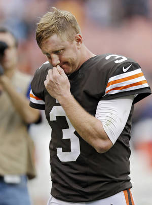 Photo - Cleveland Browns quarterback Brandon Weeden walks off the field after a 31-17 loss to the Detroit Lions in an NFL football game Sunday, Oct. 13, 2013, in Cleveland. (AP Photo/Tony Dejak)