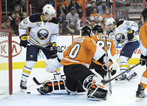 photo - Buffalo Sabres' Brian Flynn (65) shoots and scores a goal past Philadelphia Flyers' Ilya Bryzgalov (30), of Russia, in the first period of an NHL hockey game, Sunday, March 10, 2013, in Philadelphia. (AP Photo/Michael Perez)