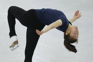 Photo - Yuna Kim of South Korea skates during a practice session at the figure stating practice rink at the 2014 Winter Olympics, Monday, Feb. 17, 2014, in Sochi, Russia. (AP Photo/Vadim Ghirda)