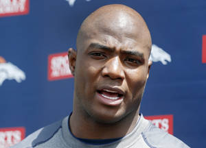 Photo - Denver Broncos defensive end DeMarcus Ware  talks to the media after working out at the NFL football teams training facility in Englewood, Colo., on Monday, April 21, 2014. (AP Photo/Ed Andrieski)