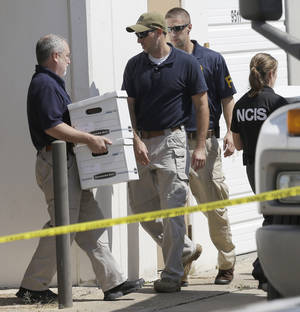 photo -   Federal agents carry boxes out of Arc Electronics Inc. Wednesday, Oct. 3, 2012 in Houston. A Kazakhstan-born businessman was charged in the U.S. on Wednesday with being a secret Russian agent involved in a scheme to illegally export microelectronics from the United States to Russian military and intelligence agencies. (AP Photo/David J. Phillip)