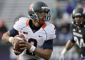 Photo -   Illinois quarterback Nathan Scheelhaase (2) runs as he looks to a pass during the first half of an NCAA college football game against Northwestern in Evanston, Ill., Saturday, Nov. 24, 2012. (AP Photo/Nam Y. Huh)
