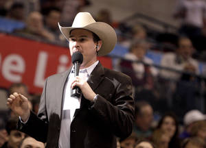 Photo - PBR Arena Announcer Brandon Bates talks to the crowd during the Winstar World Casino Invitational PBR event at the Chesapeake Energy Arena in Oklahoma City, Friday, Feb. 10, 2012. Photo by Sarah Phipps, The Oklahoman