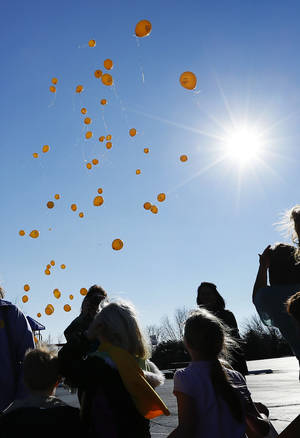 Photo - Students, parents and teachers at Sunnybrook Christian School in Stillwater watch as balloons are released during a Balloon Launch for School Choice on Thursday. Photo by Nate Billings, The Oklahoman <strong>NATE BILLINGS - NATE BILLINGS</strong>