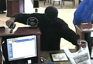photo - Two men with handguns robbed the BancFirst branch at 4200 S Sunnylane Road in Oklahoma City. photos provided