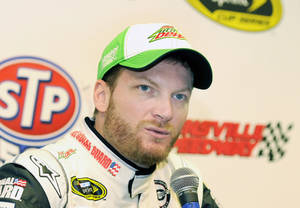 Photo - NASCAR Sprint Cup driver Dale Earnhardt Jr. speaks to the media during a press conference prior to practice at Martinsville Speedway in Martinsville, Va., Friday March 28, 2014. (AP Photo/Mike McCarn)