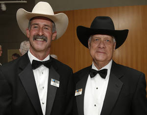 Photo -  Board of Directors Wyatt McCrea, left, and John Wroten pose for a picture on Saturday during the Western Heritage Awards at the National Cowboy & Western Heritage Museum. Photo by Sarah Phipps, The Oklahoman  <strong>SARAH PHIPPS -  SARAH PHIPPS </strong>