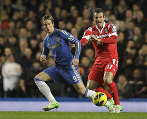 Photo - Chelsea's Fernando Torres, left, competes with Queens Park Rangers' Ryan Nelsen during their English Premier League soccer match at Stamford Bridge, London, Wednesday, Jan. 2, 2013. (AP Photo/Sang Tan)