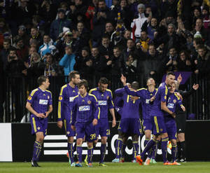 Photo - Players of Maribor celebrate their first goal against Sevilla  during their Europa League round of 32, first leg soccer match, in Maribor, Slovenia, Thursday, Feb. 20, 2014. (AP Photo/Filip Horvat)