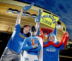 "photo - Thunder super fans, from left, Zeb Benbrook, ""Thunder Man""  Derrick  Seys, and Angela Love pose for a portrait outside the Ford Center in Oklahoma City, Thursday, Feb. 12, 2009. By Bryan Terry"