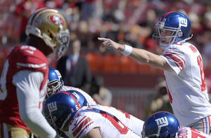 photo -   New York Giants quarterback Eli Manning (10) calls a play at the line of scrimmage against the San Francisco 49ers during the first quarter of an NFL football game in San Francisco, Sunday, Oct. 14, 2012. (AP Photo/Mark J. Terrill)