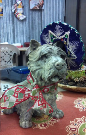 A Toto figurine stands guard at Toto&#039;s Tacoz, next door to the Oz Museum in Wamego, Kansas. Photo by Annette Price, for The Oklahoman. &lt;strong&gt;&lt;/strong&gt;