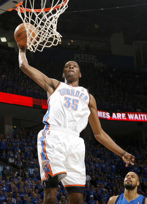 Photo - Oklahoma City's Kevin Durant (35) goes up for a dunk during game 4 of the Western Conference Finals in the NBA basketball playoffs between the Dallas Mavericks and the Oklahoma City Thunder at the Oklahoma City Arena in downtown Oklahoma City, Monday, May 23, 2011. Photo by Nate Billings, The Oklahoman