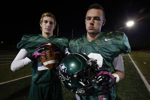 photo - Norman North receivers Corbin Cleveland, left, and Jake Higginbotham combined for 251 yards in the Timberwolves' win against Owasso in the Class 6A semifinals. Photo by Steve Sisney, The Oklahoman