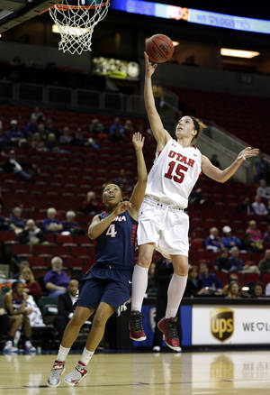 photo - Utah's Michelle Plouffe (15) shoots over Arizona's Carissa Crutchfield (4) during the first half of an NCAA college basketball game in the Pac-12 Conference tournament on Thursday, March 7, 2013, in Seattle. (AP Photo/Ted S. Warren)