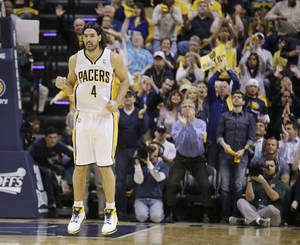 Photo - Indiana Pacers' Luis Scola (4) celebrates during the second half in Game 2 of an opening-round NBA basketball playoff series against the Atlanta Hawks Tuesday, April 22, 2014, in Indianapolis. Indiana defeated Atlanta 101-85. (AP Photo/Darron Cummings)