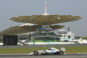Photo - Mercedes driver Nico Rosberg of Germany steers his car during the first practice session for Sunday's Malaysian Formula One Grand Prix at Sepang International Circuit in Sepang, Malaysia, Friday, March 28, 2014. (AP Photo/Peter Lim)