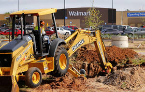 Photo -  Workers bury conduit that will carry electrical connections to a gas station that will be built on the property of Choctaw's first Walmart, scheduled to open in mid-July. Photo by Jim Beckel, The Oklahoman  <strong>Jim Beckel -   </strong>