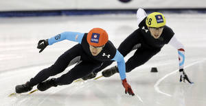 Photo - J.R. Celski, left, and Kyle Carr, right, competes in the men's 1,500 meters during the U.S. Olympic short track trials, Friday, Jan. 3, 2014, in Kearns, Utah. (AP Photo/Rick Bowmer)