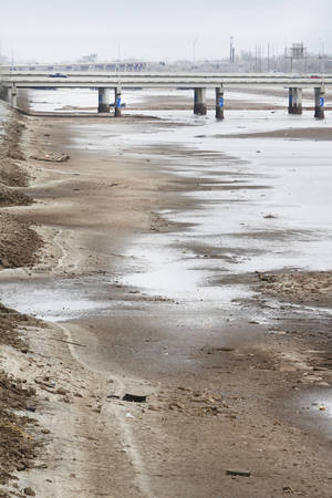 photo - The eastern basin of the Oklahoma River lays dry near I-40 in Oklahoma City, Friday December 14, 2012. Photo By Steve Gooch, The Oklahoman <strong>Steve Gooch - The Oklahoman</strong>