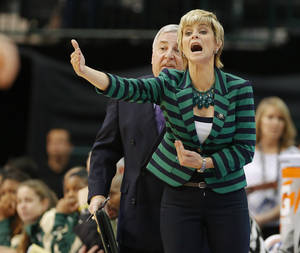 Photo - Baylor coach Kim Mulkey shouts instructions during the Big 12 tournament women's college basketball game between Oklahoma State University and Baylor at American Airlines Arena in Dallas, Sunday, March 10, 2012.  Oklahoma State lost 77-69. Photo by Bryan Terry, The Oklahoman
