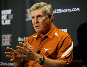 Photo - Texas head coach Mack Brown answers questions during NCAA college football Big 12 Media Days, Monday, July 25, 2011, in Dallas. (AP Photo/Matt Strasen) ORG XMIT: TXMS102