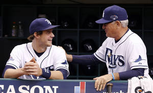 Photo - Tampa Bay Rays manager Joe Maddon, right, speaks with right fielder Wil Myers before the start of Game 3 of an American League baseball division series against the Boston Red Sox, Monday, Oct. 7, 2013, in St. Petersburg, Fla. (AP Photo/Mike Carlson)