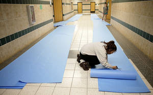 photo - Edmond Santa Fe senior Jenney Huynh, 18, cuts paper to cover the walls of Edmond Santa Fe High School for Double Wolf Dare Week in Edmond, Okla., Friday, Feb. 22, 2013. Photo by Bryan Terry, The Oklahoman