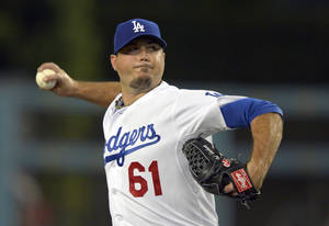 Photo -   FILE - This Sept. 13, 2012 file photo shows Los Angeles Dodgers starting pitcher Josh Beckett throwing during the first inning of a baseball game against the St. Louis Cardinals in Los Angeles. A company owned by Beckett is suing a pipeline builder claiming it destroyed the habitat of the endangered ocelot on a South Texas ranch. The lawsuit filed Tuesday in Laredo says Eagle Ford Midstream LP violated the federal Endangered Species Act by clearing land to build a natural gas pipeline. (AP Photo/Mark J. Terrill, File)