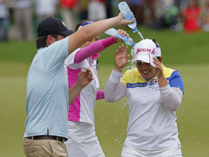 Photo -   Inbee Park, right, of South Korea is splashed with water after winning the LPGA Malaysia golf tournament at Kuala Lumpur Golf and Country Club in Kuala Lumpur, Malaysia, Sunday, Oct. 14, 2012. (AP Photo/Lai Seng Sin)