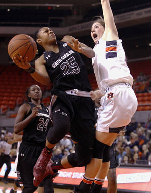 Photo - South Carolina's Tiffany Mitchell (25) goes up for a shot over Auburn's Katie Frerking (13) during the second half of an NCAA college basketball game on Sunday, Jan. 12, 2014, in Auburn, Ala. South Carolina defeated Auburn 72-66. (AP Photo/Butch Dill)