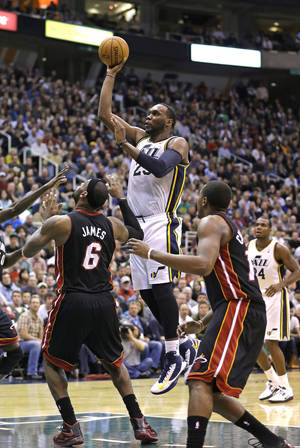 photo - Utah Jazz center Al Jefferson (25) shoots as Miami Heat forward LeBron James (6) and guard Mario Chalmers, right, look on in the fourth quarter during an NBA basketball game Monday, Jan. 14, 2013, in Salt Lake City. The Jazz defeated the Heat 104-97. (AP Photo/Rick Bowmer)