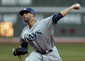 Photo - FILE - In this Oct. 5, 2013, file photo, Tampa Bay Rays starting pitcher David Price delivers against the Boston Red Sox during the first inning of Game 2 of baseball's American League division series in Boston. The three-time AL All-Star and the Rays have agreed to a $14 million, one-year contract, the highest single-season salary in franchise history. (AP Photo/Charles Krupa, File)