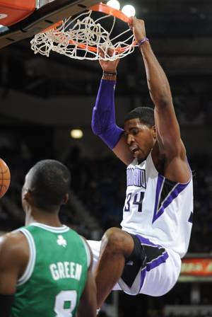Photo - Jason Thompson of the Sacramento Kings dunks against the Boston Celtics  during an NBA basketball game on Sunday, Dec. 30, 2012 at Sleep Train Arena in Sacramento, Calif. (AP Photo/ The Sacramento Bee, Hector Amezcua)MANDATORY CREDIT