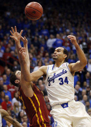 Photo - Kansas forward Perry Ellis (34) and Iowa State forward Georges Niang reach for a rebound during the first half of an NCAA college basketball game in Lawrence, Kan., Wednesday, Jan. 29, 2014. (AP Photo/Orlin Wagner)