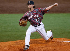 Photo - Louisiana-Lafayette pitcher Cody Boutte pitches in the first inning during an NCAA college baseball tournament regional game against Mississippi State in Lafayette, La., Sunday, June 1, 2014. (AP Photo/Jonathan Bachman)