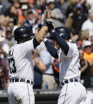 Photo - Detroit Tigers' Ian Kinsler, right, is congratulated by teammate Alex Avila after Kinsler's two-run home run during the fifth inning of a baseball game against the Cleveland Indians in Detroit, Thursday, April 17, 2014. (AP Photo/Carlos Osorio)