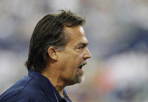 Photo - St. Louis Rams head coach Jeff Fisher makes a call from the sideline against the Dallas Cowboys during the second quarter of an NFL football game on Sunday, Sept. 22, 2013, in Arlington, Texas. (AP Photo/LM Otero)