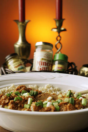 Photo -      This curried chicken is heart-smart and can be prepared in a slow-cooker. Photo by Doug Hoke, The Oklahoman  <strong>DOUG HOKE -  THE OKLAHOMAN </strong>