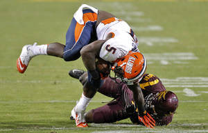 Photo -   Illinois running back Donovonn Young (5) is tackled by Arizona State safety Alden Darby during the second half of an NCAA college football game, Saturday, Sept. 8, 2012,in Tempe, Ariz. (AP Photo/Matt York)