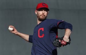 Photo - Cleveland Indians pitcher John Axford throws during spring training baseball practice in Goodyear, Ariz., Thursday, Feb. 13, 2014. (AP Photo/Paul Sancya)