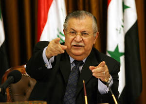 photo - FILE - In this Friday, Aug. 17, 2007 file photo, Iraq's President Jalal Talabani talks to reporters in Baghdad, Iraq. A doctor who oversees Talabani's medical care when he is in Iraq, says the president, who is currently in Germany for treatment, is able to speak with and understand those around him more than two months after suffering a stroke. (AP Photo/ Hadi Mizban, File)