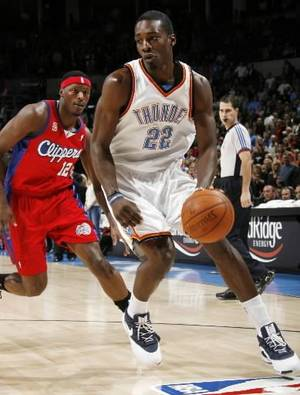 Photo - Jeff Green of the  Thunder dribbles in front of Al Thornton of the Clippers in the first half of the NBA basketball game between the Oklahoma City  Thunder and the Los Angeles Clippers at the Ford Center in Oklahoma City Wednesday. Photo by Nate Billings