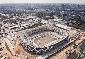 Photo - In this photo released by Portal da Copa 2014, an aerial view of the Arena da Amazonia stadium, in Manaus, Brazil, October, 2013. The draw for the 2014 World Cup finals takes place Friday Dec. 6, 2013 near Salvador, Brazil. The 32 teams will be drawn into eight groups of four. The top two in each group will progress to the knockout stages. Twelve stadiums in twelve cities will host matches.(AP Photo/Portal da Copa 2014, Jose Zamith de Oliveira Filho)