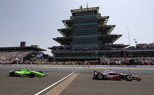 Photo - FILE - In this May 27, 2012, file photo, Ryan Briscoe, of Australia, leads James Hinchcliffe, of Canada, across the start/finish line on the start of the Indianapolis 500 auto race at Indianapolis Motor Speedway in Indianapolis. The Hulman-George family should retain ownership of the IndyCar Series and Indianapolis Motor Speedway, according to a report from a consulting group hired by Hulman&Co. to evaluate its business operations, including running the Indianapolis 500. (AP Photo/Darron Cummings, File)