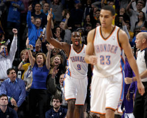 photo - Oklahoma City's Serge Ibaka (9) reacts after a three-point basket during an NBA basketball game between the Oklahoma City Thunder and the Los Angeles Lakers at Chesapeake Energy Arena in Oklahoma City, Tuesday, March. 5, 2013. Photo by Bryan Terry, The Oklahoman