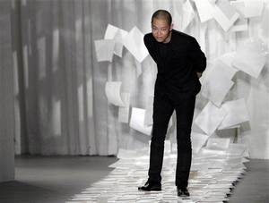 "Photo - FILE - In this Sept. 9, 2011 file photo, designer Jason Wu takes a bow after presenting his Spring 2012 collection during Fashion Week in New York. Judges in his native Taiwan seem unimpressed that Wu has designed two inaugural gowns for U.S. first lady Michelle Obama. Taiwan's Intellectual Property Court ruled Monday, Jan. 21, 2013 that Wu's new label ""Miss Wu"" could not be registered as a brand because it was not distinctive enough. He designed the white gown Michelle Obama wore for her husband's first inauguration in 2009. On Monday, she appeared in another of his creations, a shiny gown with a red halter top. (AP Photo/Mary Altaffer, File)"